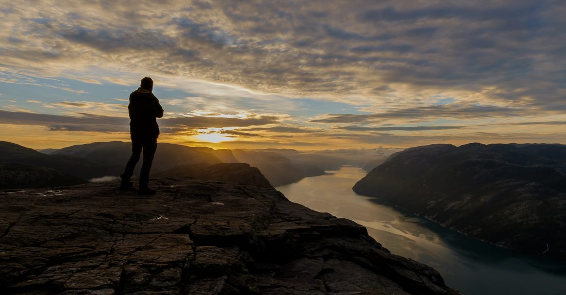 Me watching the sunrise on the Preikestolen, Norway