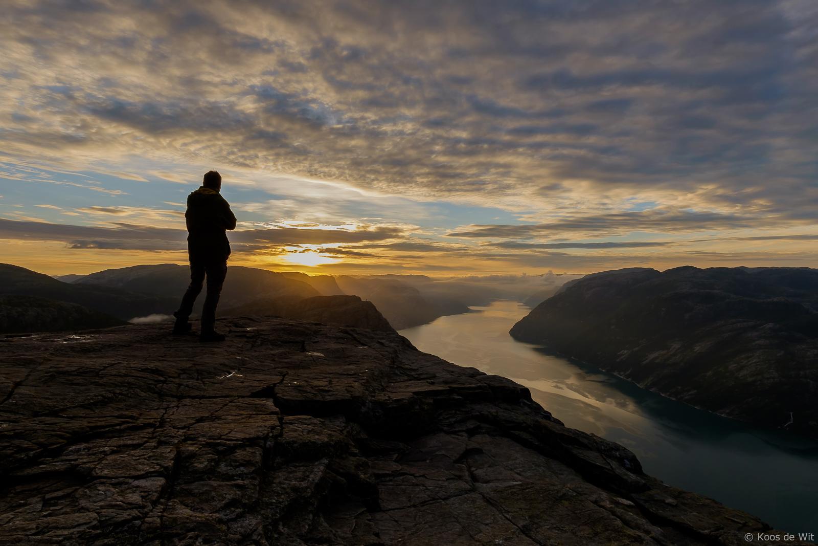 Me watching the sunrise on the Preikestolen, Norway
